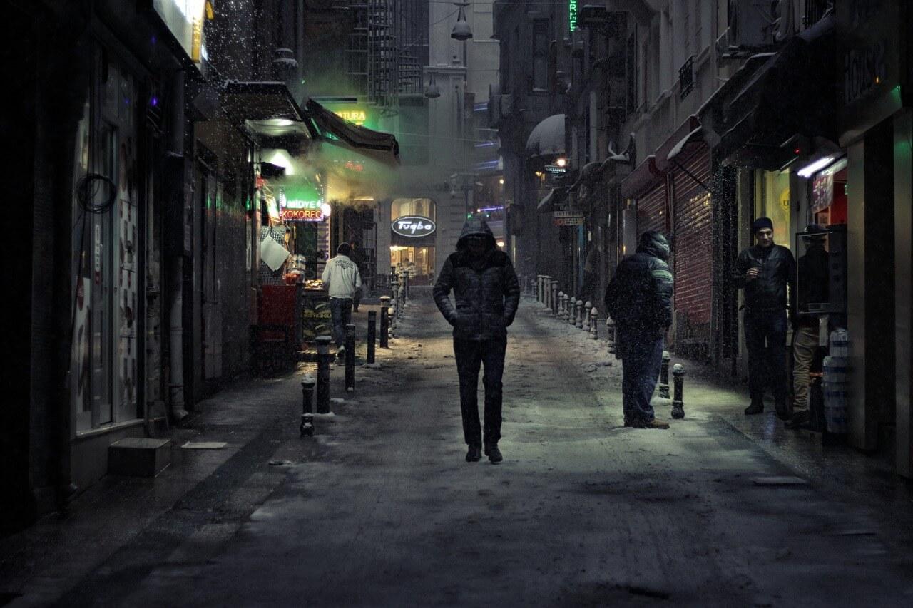 Man Walking In An Alley In Winter