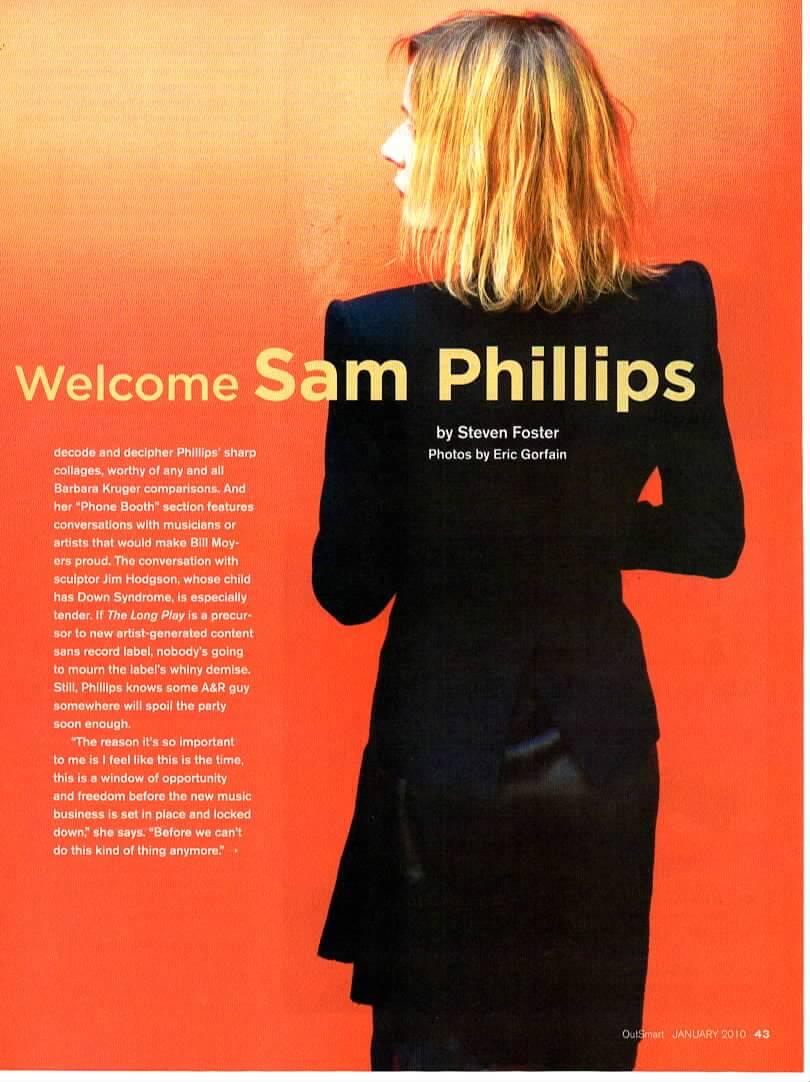Singer/Songwriter Sam Phillips on an orange background, her back to the camera, dressed in black, looking over her left shoulder