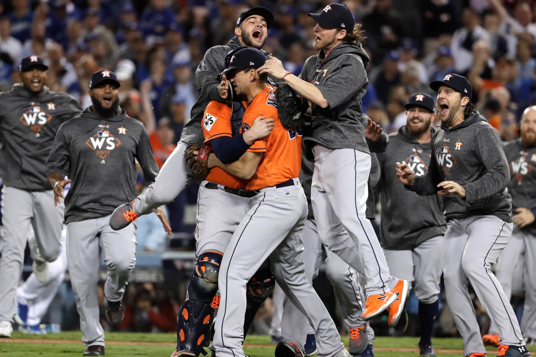 Astros celebrating on the field after winning the world series