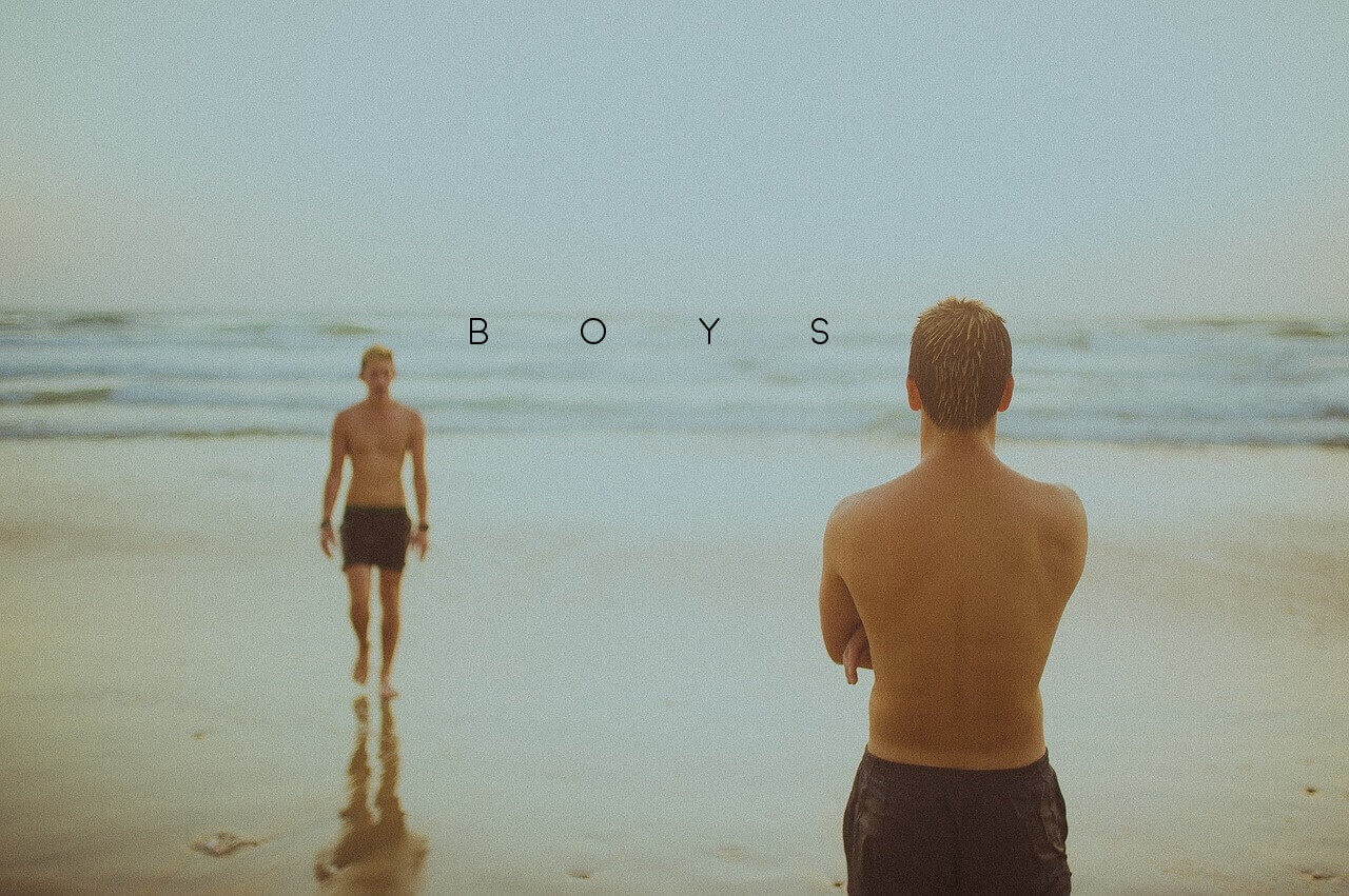 one boy walking up to another boy on a beach with the nuff said essay title boys